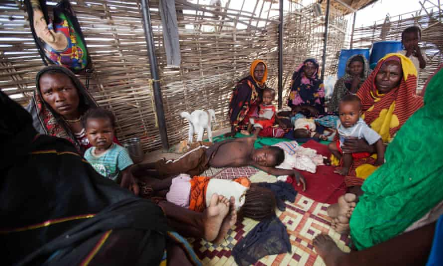 Women and children shelter at the al-Salam camp in South Darfur, Sudan, where women have been disproportionately affected by rice has increased.