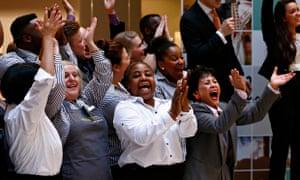 John Lewis and Waitrose employees cheer as their 2014 bonus is announced