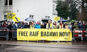 Protesters call for the release of Raif Badawi outside the Saudi embassy in The Hague, Netherlands