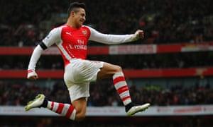 Alexis Sánchez jumps for joy after scoring in the Premier League against Stoke City.