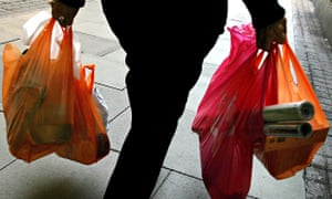 A person with supermarket shopping in bags