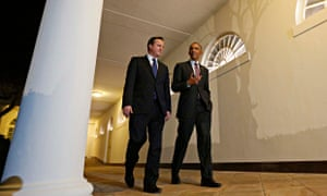 David Cameron and Barack Obama walk together at the White House in Washington