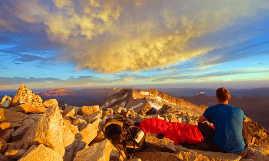 A climber enjoying sunrise in the Pyrenees,