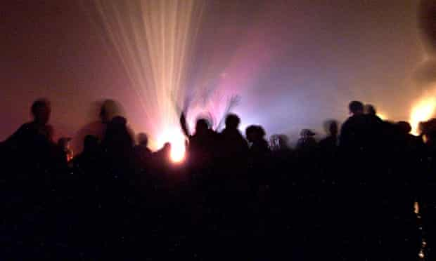 Dancers at a rave, which is typically associated with the taking of the 'feel-good' drug ecstasy