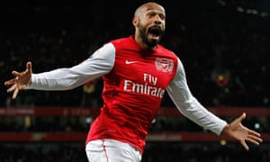 Thierry Henry in an Arsenal shirt looks joyous with arms outstretched after scoring a goal