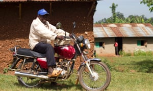 Elam Kangaya, 43, was able to buy a motorcycle with the profits from his farm