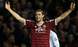 Andy Carroll wearing West Ham shirt sponsored by Alpari.