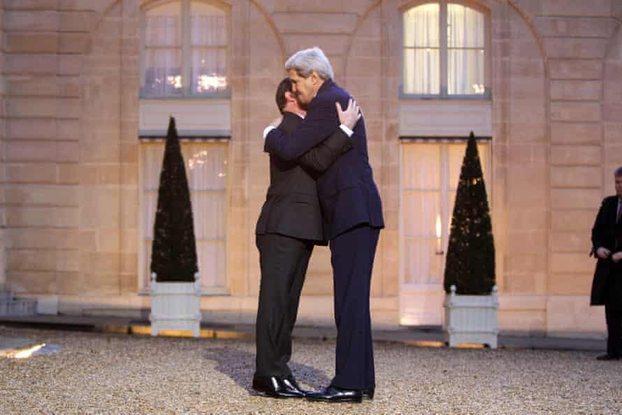 US Secretary of State John Kerry embraces French President Francois Hollande on Friday.