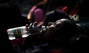 Indian woman drinking water