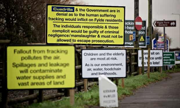 Anti-fracking signs line the road next to a proposed shale gas site in Lancashire.