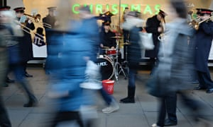 The Salvation Army entertains Christmas shoppers in Oxford Street, London