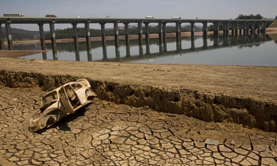 The frame of a car on the cracked earth at the bottom of the Atibainha dam, part of the Cantareira system, in October.