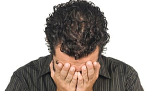 25 years old Middle Eastern man crying with head in hands