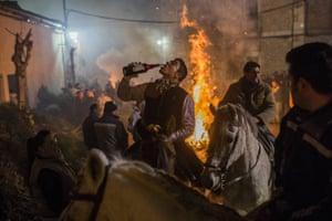 A horse rider takes a drink during the ritual in San Bartolome de Pinares