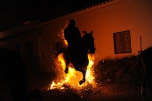 A horseman jumps over a bonfire during the celebrations.