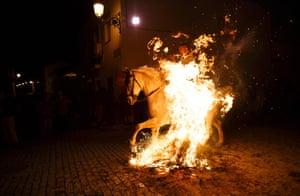 A man rides through the flames.
