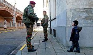 Belgian paratroopers guard outside a Jewish school in Antwerp