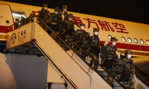 A medical team sent by China to Liberia to assist in the fight against Ebola arrives back at Chongqing Jiangbei International airport.