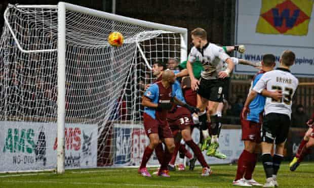 Matt Smith of Bristol City heads goalwards against Scunthorpe United in their League One encounter