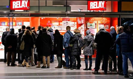 Customers queue to buy the first edition of Charlie Hebdo since the terror attack on the magazine