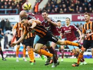 West Ham's James Collins dives in for a header with Hull's James Chester as West Ham take a 3-0 victory at the Boleyn Ground.