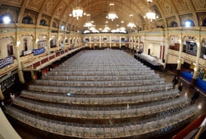 Pigeons in their cages, ready to be admired and judged at the Winter Gardens, Blackpool.