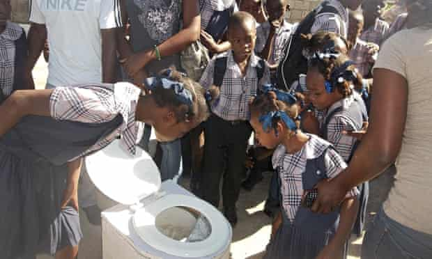 Children in Haiti learning about waste