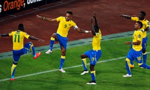 Pierre-Emerick Aubameyang celebrates his goal with his Gabon team mates after scoring against Burkina Faso during the 2015 African Cup of Nations.