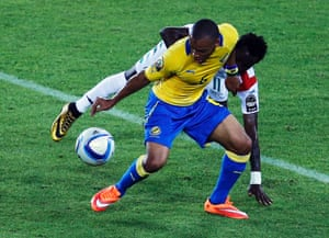 Johann Obiang (front) of Gabon fights for the ball with Jonathan Pitroipa of Burkina Faso during Saturday's match.