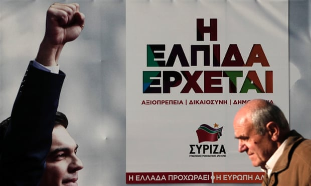 A man walks past a banner with an image of opposition leader and head of radical leftist Syriza party Alexis Tsipras at the party's pre-election kiosk in Athens.