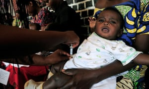 An infant receives a pneumococcal vaccine at the Nyamata health centre in Rwanda.