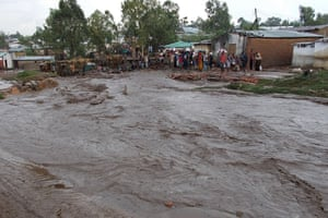 Villagers stand on flooding street in Malawi
