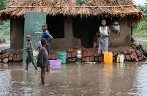 Family waits for relief during Malawi flooding