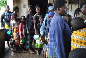 Malawians queue for food at primary school