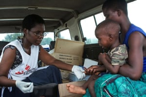 MSF worker tends young child