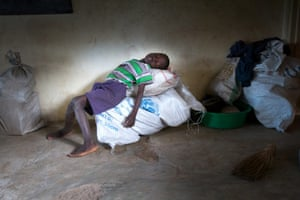 A young boy sits on sacks of food aid in Chikwawa.