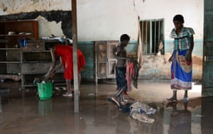 Mother and children salvage belongings Malawi floods