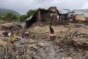 Girls cross stream flooding Malawi