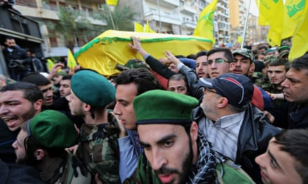 Lebanese Hezbollah supporters carry the coffin of Jihad Mughniyeh, one of the fighters killed in Sun