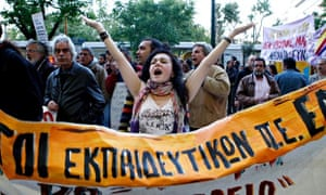 Protesters outside the Greek parliament in Athens during a demonstration against the Government's fi