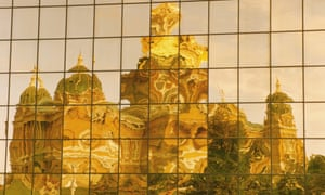 Reflection of a cathedral in an office building
