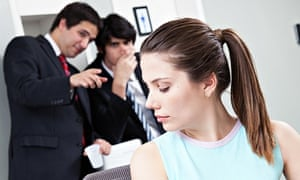 men laughing at woman in the office