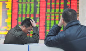 Investors falling share prices at a Chinese stockbroker firm's office in Fuyang, Anhui province.