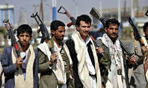 Armed members of Houthis gather at Sebin Square as they close the Sebin Road to traffic near preside