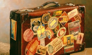 OLD SUITCASE SHOWING HOLIDAY DESTINATION LABELS.