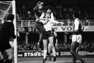Ollie Kearns of Hereford United is held by David O'Leary of Arsenal whilst Arsenal goalkeeper John Lukic punches the ball clear during their 1-1 draw  in 1985. Hereford's dreams of a Cup upset were smashed at the Highbury where Arsenal routed Hereford 7-2 in the replay