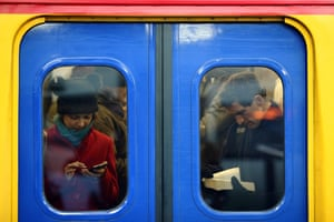 London, UK. Passengers stand on a train at Clapham Junction - increased rail fares averaging 2.5% came into effect today