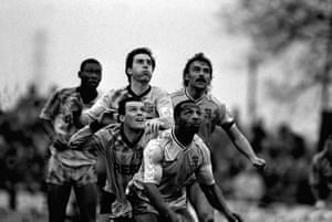 Cyrille Regis & Brian Kilcline keep an eye on the ball as First Division Coventry City crash out to non - league Sutton United.