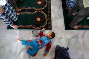 Masjid Al-Akbar, Indonesia A boy sleeps on the floor as Muslims perform Friday prayers, which included a special prayer for the passengers of AirAsia Flight QZ8501. International experts equipped with sophisticated acoustic detection devices joined search teams scouring the sea off Borneo on Friday in the hunt for the black box flight recorders from the passenger jet