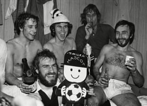 Tooting and Mitcham players and their mascot celebrate in the dressing room after their 2-1 win over Swindon Town in 1976